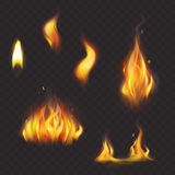 Set of realistic flame tongues isolated on a dark background. Royalty Free Stock Photography