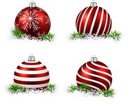 Set of realistic red christmas balls. Colorful set of red realistic christmas balls on snow with fir branches. Vector illustration Stock Photos
