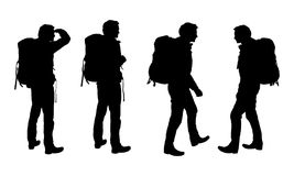 Set of realistic  silhouettes of tourist men with backpack Stock Image