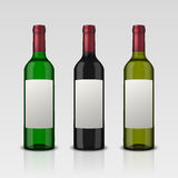 Set 3 realistic vector bottles of wine with blank labels isolated on white background. Design template in EPS10. Set 3 realistic vector bottles of wine with Royalty Free Stock Photography