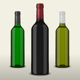 Set 3 realistic vector bottles of wine without labels  on white background. Design template in EPS10. Set 3 realistic vector bottles of wine without labels  on Royalty Free Stock Images