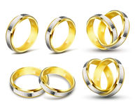 Set of realistic vector illustrations of gold wedding rings with engraving Stock Photography