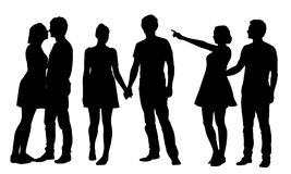 Set of realistic vector silhouettes of young girl and man embrac. Ing and kissing, isolated on white background Stock Photography