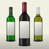 Set 3 realistic vector wine bottles with blank labels  on white background. Design template in EPS10. Set 3 realistic vector wine bottles with blank labels  on Royalty Free Stock Photos