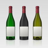 Set of 3 realistic vector wine bottles with blank labels  on white background. Design template in EPS10. Set of 3 realistic vector wine bottles with blank Royalty Free Stock Images