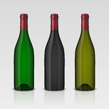 Set of 3 realistic vector wine bottles without labels  on white background. Design template in EPS10. Set of 3 realistic vector wine bottles without labels  on Royalty Free Stock Images