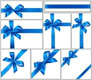 Set of realistic white gift box with blue bow and ribbon for gift decor. Holiday decorations. Vector illustration. Vector collection of blue bows and ribbons for Stock Photography
