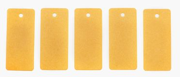 Five recycled paper tags with a notebook isolated on white background stock photography