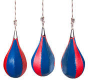 Set from red and blue leather boxing pears. Set from pear shaped red and blue leather speed balls - boxing punch bags isolated on white background Stock Photo