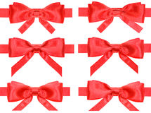 Set of red bow knots on satin ribbons isolated Royalty Free Stock Photography