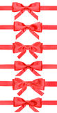 Set of red bows on satin ribbons isolated Royalty Free Stock Image