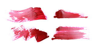 Set of red brush strokes of acrilic paint as sample of art product Stock Photography