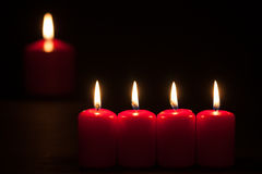 Set of red candles burning in the dark Royalty Free Stock Photo