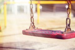 Set of red chain swings on modern kids playground stock photography