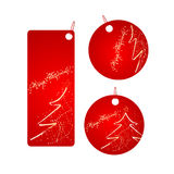 Set of red christmas badges. Set of vector three red badges with sparkling christmas design Royalty Free Stock Image