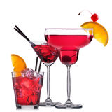 Set of red cocktails with decoration from fruits and colorful straw isolated on white background.  royalty free stock photo