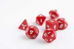 Set of red dices for rpg, dnd, tabletop or board games on light background. Hobby Royalty Free Stock Image