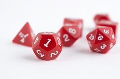 Set of red dices for rpg, dnd, tabletop or board games on light background. Hobby Stock Image