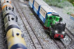 Set of red electric model railway locomotive and layout with a station and whole scene with features. royalty free stock image