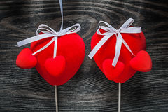 Set of red fabric hearts with white ribbons on wooden board holi Royalty Free Stock Photography