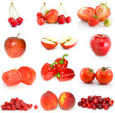 Set of red fruits, berries and vegetables. On the white background Royalty Free Stock Images