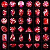 Set of red gems of different cuts and shapes Royalty Free Stock Photo