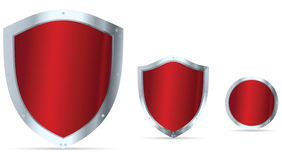 Set of red glossy steel shields Royalty Free Stock Images