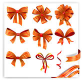 Set of red and gold gift bows with ribbons Stock Image