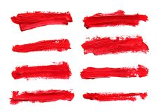 Set of red gouache brush strokes. Set of red abstract gouache brush strokes on a white background Stock Photos