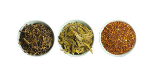 Set of red, green and black dry tea, isolated. On white Royalty Free Stock Images