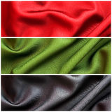 Set of red, green and black fabric Stock Image