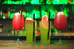Set of red and green cocktails. In glasses and cups Royalty Free Stock Photos
