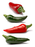 Set of red and green peppers, paths. Set of standalone red and green hot chili peppers. Clipping paths, shadows separated, infinite depth of field. Design Royalty Free Stock Photography