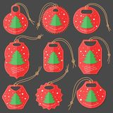 Set of Red-Green Tags on the Dark Background Made in Flat Style with Snowfall and Sample Text. Isolated Group of Hang Tags for. Christmas Holiday Market and stock illustration