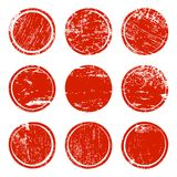 Set of red grunge texture circles. Red grunge texture circles isolated on white background. Set of blank post stamp, banner, logo, badge and label template Royalty Free Stock Image