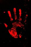 Set of red hand prints on black background.  royalty free stock images