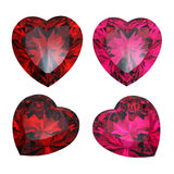 Set of red heart shaped ruby and garnet Stock Photos