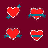 Set of red hearts budges with stripes. Royalty Free Stock Photos