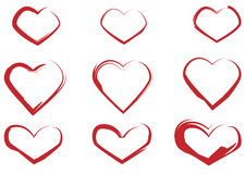Set of red hearts painted with a brush Stock Photos