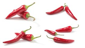 Set of Red hot chilli peppers isolated. On white background stock photo