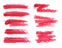 Set of red lipstick smudge isolated on white background. Smudged makeup product sample. Stock Image