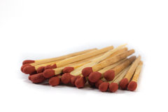 Set of red matches close up on white background Royalty Free Stock Images