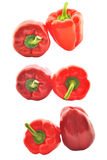 Set of red paprikas. Isolated on white Royalty Free Stock Photos