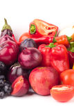 Set of red and purple fresh raw vegetables and fruits Royalty Free Stock Images