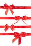 Set of red ribbon satin bows. Isolated on white Royalty Free Stock Photo