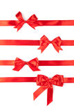 Set of red ribbon satin bows. Isolated on white Royalty Free Stock Photography