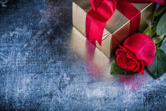 Set of red rose present box on scratched metallic background.  Royalty Free Stock Images