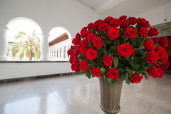 Set of red roses arranged in a stone vase. Quito Stock Images