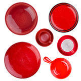 Set of red round plates. Or dishes isolated on white Stock Images