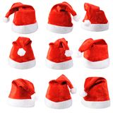 Set of red Santa Claus hats. Isolated on white background Royalty Free Stock Photography